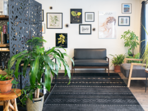 Ivy + Oak Salon waiting room with a collage of botanical prints and hair photos with a variety of plants