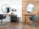 Ivy + Oak salon stations with white and wood walls reflected back in circle mirrors